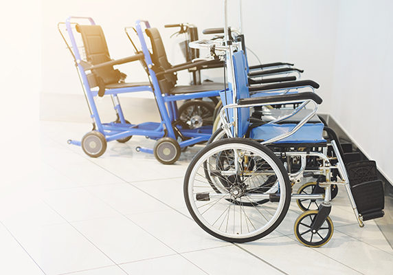 Empty wheelchair parked in hospital